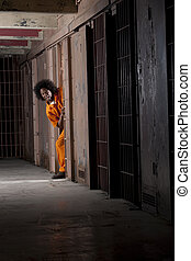 Young Man Breaking Out of Prison - A young man wearing an...