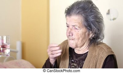 quot;old woman gets pills, drinks waterquot; - unhealthy old...