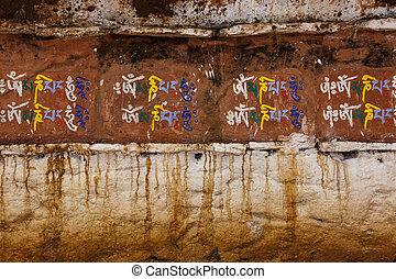 Sanskrit Writing on a Stupa - Colorful Sanskrit writing on...