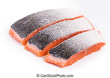 Fresh uncooked red fish fillet slices Isolated on a white...