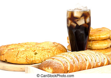 black drink cola and donuts and sugar over lettuce over...