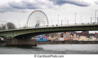 bridge over the river in Cologne, overlooking the amusement...