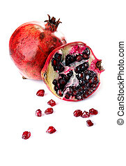 Pomegranate and pieces isolated on white background