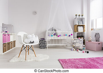 Great example of a well-designed nursery - Shot of a cosy...