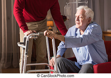 Senior with walking zimmer - Image of disabled senior man...