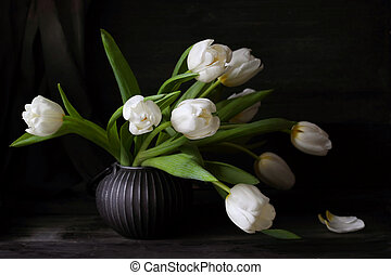 Bouquet of white tulips on a black background
