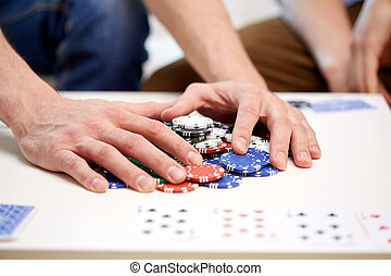 hands with casino chips making bet or taking win - leisure,...