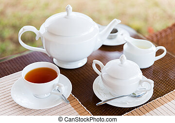 close up of tea service at restaurant or teahouse