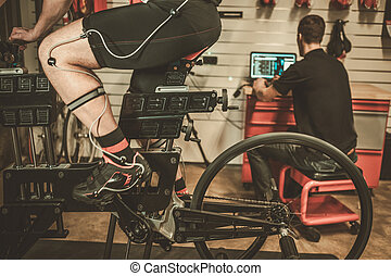 Professional cyclist being tested on body geometry simulator in fit services.