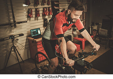 Professional cyclist being tested on body geometry simulator...