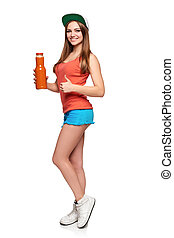 Happy teen girl holding a glass of carrot juice - Healthy...
