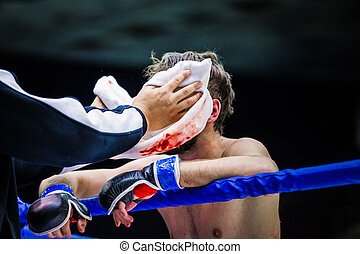 second and fighter a break between rounds - cornerman wipes...
