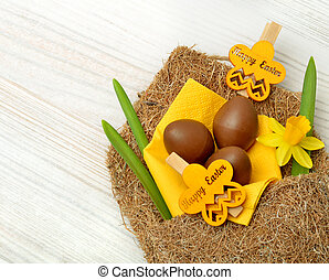 Easter decoration and fresh spring narcissus flowers. -...