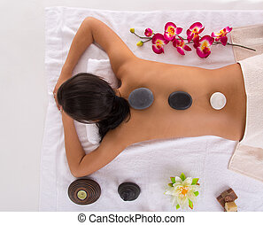 Young woman getting spa procedures - Young beautiful...