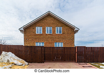 two-storey cottage of red brick - A two-storey cottage of a...