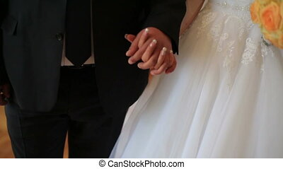 Young married couple softly holding hands. ?eremony wedding...