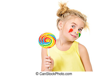 sweet eater - Cute little girl with painted colorful cheeks...