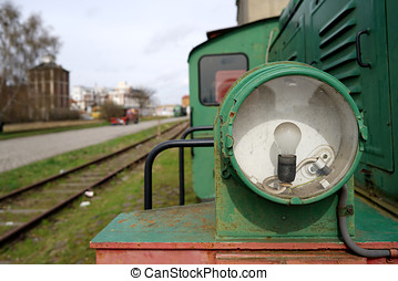 Headlight - Headlight of a historic locomotive in the port...