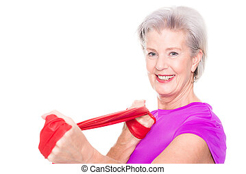 Sportive senior woman - Active and sporty senior woman in...