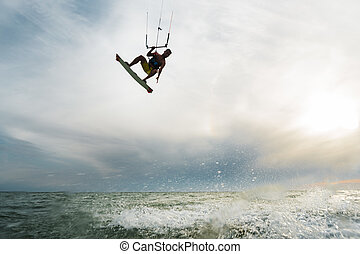 Surfer jumping over the water