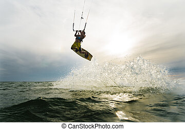 Surfer jumping at the sunset - A surfer doing an amazing...