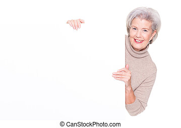 Senior woman with blank sign