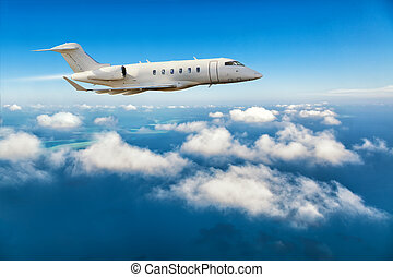 Private jet plane flying above clouds - Luxury private jet...