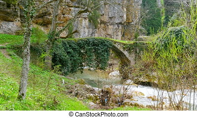 quot;Crossover, crossing the ancient medieval stone arch...