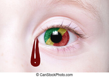 human and 39;s eye with national flag of republic congo with...