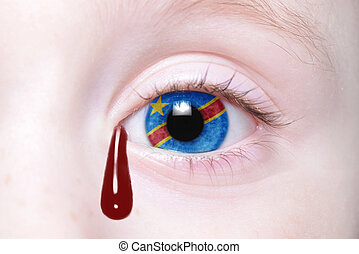 human and 39;s eye with national flag of democratic republic...