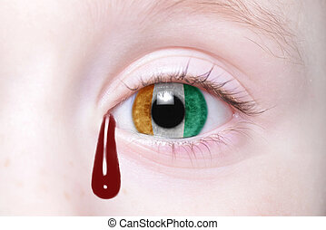 human and 39;s eye with national flag of cote divoire with...
