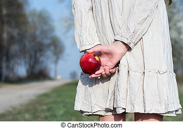 girl with a red apple in hand