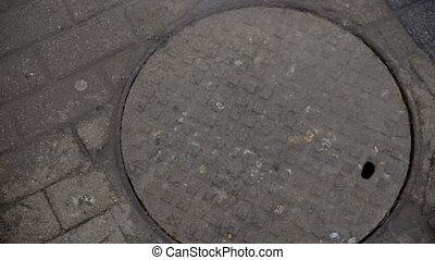 manhole smokes on the street.