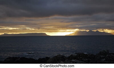 Sunset at west coast of Scottish Highlands, UK - Sunset over...