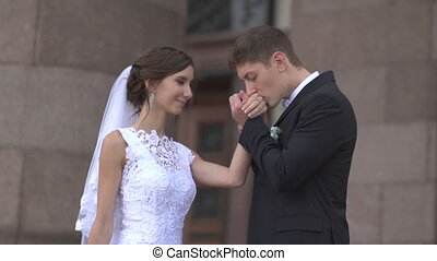 The groom kisses the bride's hand