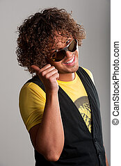 Thumbup cheerful young man with beautiful curls