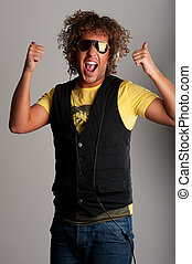 Jumping cheerful young man with beautiful curls