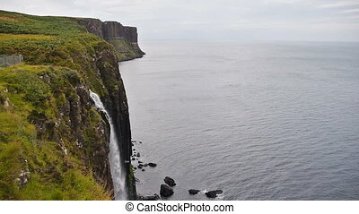 Waterfall at Kilt Rock in Quiraing, Scotland - Waterfall at...