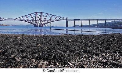 Firth of Forth Bridge in Scotland - Train crossing the irth...