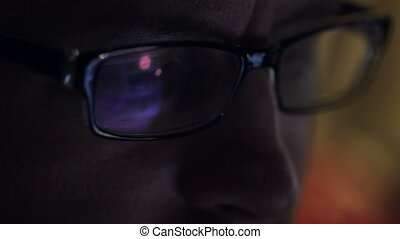 man with glasses looking at the tablet closeup