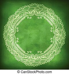 Beautiful lace frame on a green background with grunge effects.