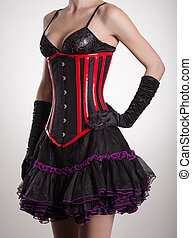 Close-up shot of beautiful woman in black and red corset