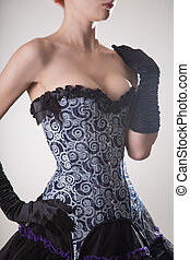 Close-up shot of sexy young woman in blue corset and black...