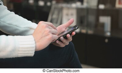 Young girl using a smart phone at the beauty salon - Young...