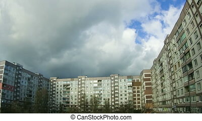 Clouds Moving over the Multistorey Buildings Time Lapse....