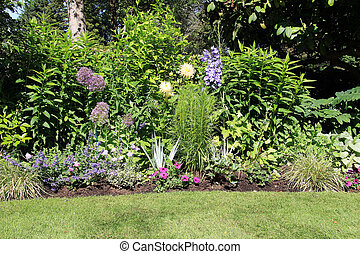 Perennial park garden flower bed in summer