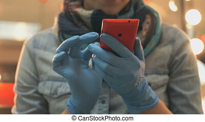 Master holding a phone red in blue rubber gloves