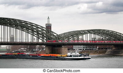 View of the bridge from the train and river barge in Cologne