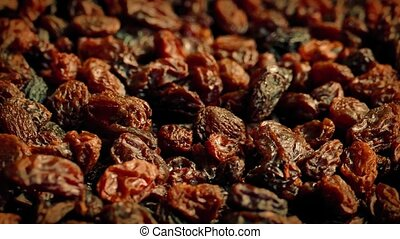 Raisins Rotating Closeup - Pile of delicious raisins turning...