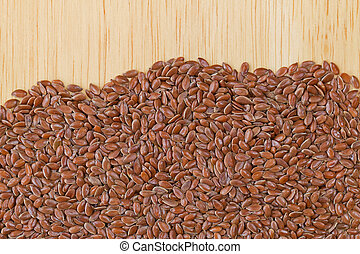 Reddish Brown seeds of Linseed, also called flaxseed on...